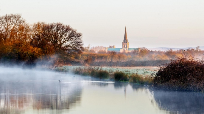 Early morning view of canal and cathedral